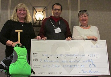 Cheque presentation at Christmas Banquet